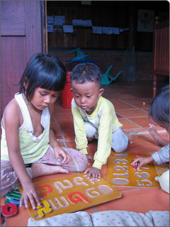 Two children playing with alphabet toys